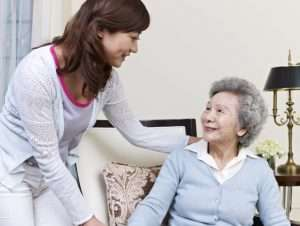 woman standing next to elderly mother