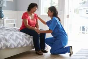 home health care professional with patient