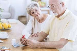 older couple looking at elderly medication